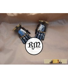 Gloves blackened, with brass ornaments.